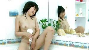 Chinese sluttish harlot is taking pleasure while fingering herself