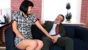 Brunette enticing strumpet is sucking wildly on the huge vulgar penis